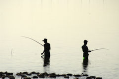 Two Fisherman Silhouette. Stock Images