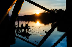 Two fisherman silhouette against sunset Royalty Free Stock Photos
