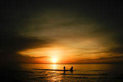 Two fisherman silhouette at sunrise Stock Photo