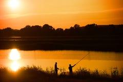 Two fishermans fishing Stock Photos