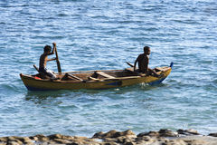 Two fishermans. (Lamalera, Indonesia). Indonesian fishermen waiting for the appearance of ten meter whale on the surface of the water. In the waters around the royalty free stock photography