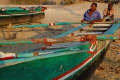 Two fishermen on the beach Stock Photo