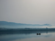 Two fishermen in a boat. Photo taken at the lake in Frydman Royalty Free Stock Photography