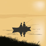 Two fishermen in a boat. Two fishermen catch fish on the river in a boat at dawn Royalty Free Stock Photography