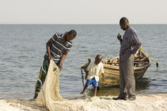 Two fishermen and a boy.