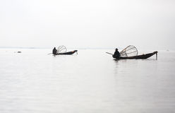 Two fishermen on canoes with fishing traps, Inle l Royalty Free Stock Photo