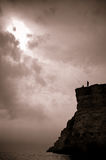 Two fishermen on a high cliff Royalty Free Stock Image