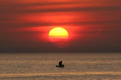 Free Two Fishermen In Boat At Sunset Stock Photo - 12736460
