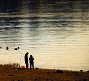 Two fishermen on the lake in the mountains in California. Royalty Free Stock Photo
