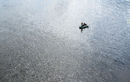 Two fishermen in the rubber boat Stock Images