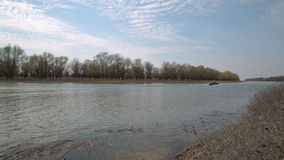 Two fishermen sailing on the old boat. With motor on the river stock video footage