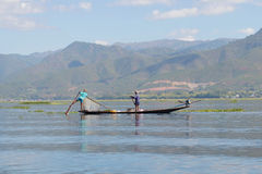 Two fishermen in the same boat. Osario, Inle Lake. Myanmar Royalty Free Stock Photography