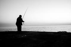 Two fishermen on sea monochrome concept Royalty Free Stock Photos