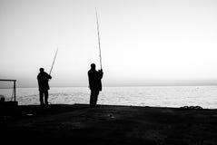 Two fishermen on sea monochrome concept Stock Photos