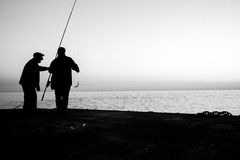 Two fishermen on sea monochrome concept Stock Images