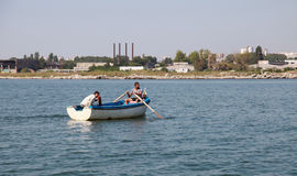 Two fishermen in wooden boat, Bay of Burgas Royalty Free Stock Images
