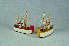 Two fishers boats. Decorative fishers boats on a white background Stock Images