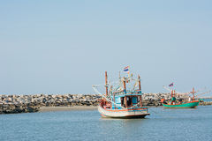 Two fishery boats floating on clam blue sea wity clear blue sky. Royalty Free Stock Photos