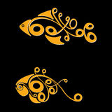 Two fishes. Two gold small fishes on a black background Stock Photo