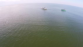 Two fishing boat on the beach. Beautiful shot of aerial view. The Boat at the sea with many photographer. They are going to take a photo in the sea,They want to stock footage