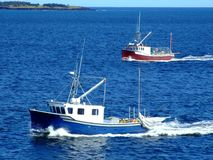 Two fishing boats. Two commercial fishing boats on there way in from fishing, Photo taken from Moshers Island Lighthouse Lahave Lunenburg County Nova Scotia Royalty Free Stock Photo