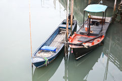 Two fishing boats anchor in the dock Royalty Free Stock Photography