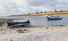 Two fishing boats anchored on coast of the Black Sea Royalty Free Stock Images