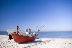 Two fishing boats on beach. Two fishing boats standing on the sand of a beach. Clear sky and horizon, nobody in the photo. The Baltic Sea Royalty Free Stock Images