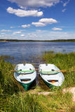 Two fishing boats at the lake in summer day Royalty Free Stock Photos