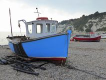 Two fishing boats on shingle beach Royalty Free Stock Images