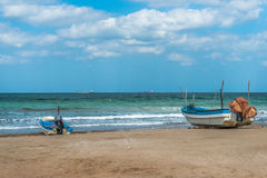 Two fishing boats on the shore. stock image