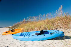 Two Fishing Kayak Boats Parked on a Sand Dune at the Beach Royalty Free Stock Photography