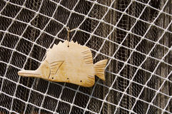 Two fishing nets and wooden fish Stock Photos