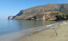 Two fishing poles. 2 Fishing poles on Fodele beach. Crete. Greece Royalty Free Stock Images
