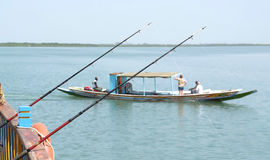 Two fishing rods on a boat Royalty Free Stock Images