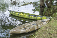 Two fishing single seat kayak on the river Stock Photos