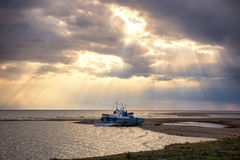 Two fishing vessel on shore Royalty Free Stock Photos