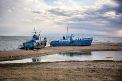 Two fishing vessel on shore Stock Image