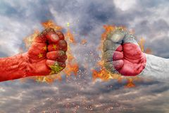 Two fist with the flag of China and Japan faced at each other. Ready for fight Stock Photos