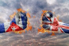 Two fist with the flag of Cuba and Great Britain faced at each other Royalty Free Stock Photos