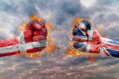 Two fist with the flag of Denmark and Great Britain faced Royalty Free Stock Photos