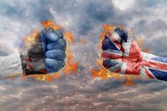 Two fist with the flag of Estonia and Great Britain faced Royalty Free Stock Photos