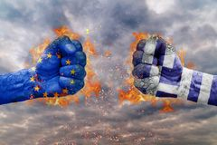Two fist with the flag of EU and Greece faced at each other royalty free stock photo