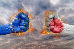 Two fist with the flag of EU and Japan faced at each other. Ready for fight Royalty Free Stock Photo