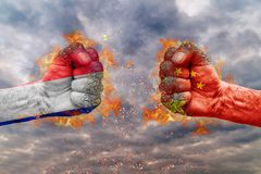 Two fist with the flag of France and China each other. Ready for fight Stock Photos