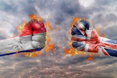 Two fist with the flag of France and Great Britain faced at each other Royalty Free Stock Images