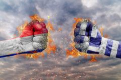 Two fist with the flag of France and Greece faced each other stock image