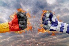 Two fist with the flag of Germany and Greece faced at each other royalty free stock photos