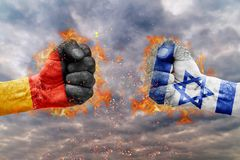 Two fist with the flag of Germany and Israel faced at each other. Ready for fight Stock Image