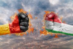 Two fist with the flag of Germany and Italy faced at each other. Ready for fight Royalty Free Stock Images
